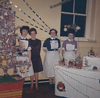 Christmas 1963 E1 ward, Sister Crompton - Nurse Margaret Bradbury in mufti - Sister Haseldine - next pupil nurse unknown.