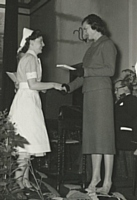 Nurse B A Brealey receiving Matrons prize for best practical nurse from the Countess of Derby.