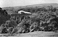 4IH A Stanier 2-6-2 tank crossing Healey Dell Viaduct with a Rochdale-Bacup train in the last week of operation in 1947. W A Camwell.