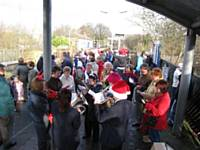 Crowds waiting on December 6th 2009 to join the Mince-Pie Special at Littleborough are entertained by the band and carol singers. Tony Young