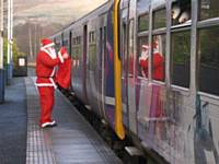 Santa waving the train off at Littleborough station in 2009