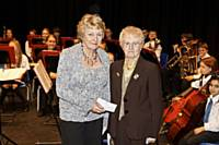 Sue Verity receives cheque from Mrs Maureen Cooper MBE