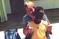 Anne McNicholas with a child during her last visit to Ethiopia