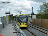Tram 3021 stops at Freehold's outbound platform on its way to Oldham Mumps on Monday 14 May 2012.  (Photo R Clarke)