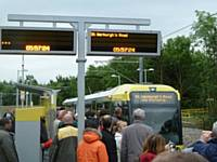 The first tram on the old 'Oldham Loop' line boarding at Oldham Mumps stop at 05:57 to form the 06:00 departure on 13 June 2012.  (Photo R Clarke.)