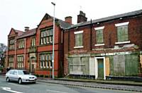 A view of the derelict building on  Manchester  Road next to the library.  Photo D Shreeve