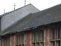 A close up of the Grosvenor Street side showing the damaged roof slates and missing guttering and downspouts. Photo D Shreeve