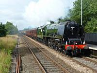 The Duchess of Sutherland, 46233,  passes Smithy Bridge, at 0929 on 3rd August 2012 with the Scarborough Flyer.  (Photo S Carmichael)