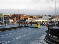 Tram 3029 crosses the busy road junction at Oldham Mumps heading for Shaw.   Photo T Young