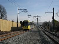 Tram 3032 heads towards Oldham and Manchester from Newbold stop, adjacent to Morrison's supermarket on 28/02/13. Photo T Young