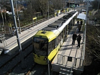 A high level view of Tram 3031 as it pauses at Milnrow on its way to Rochdale at 13.29 on 28/02/13. Photo T Young