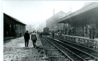 Delph station in 1956 during an enthusiasts railtour after closure of the line.
