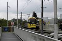 Trams 3025 and 3032 working together at Freehold stop passinger service to East Didsbury on Tuesday 21st May 2013.