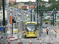 Tram 3071 and 3070 Stand at the new Mumps stop on test with  Huddersfield Rd behind on Wednesday 21/08/2013. Photo R. Clarke