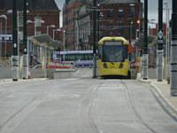 Tram 3070 stood at Oldham tram/bus interchange looking towards Union St with 3071 behind on 21/08/2013. Photo  R. Clarke