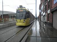 Tram 3060 calls at the Central stop, on Union Street in the centre of Oldham.  Photo J Dillon