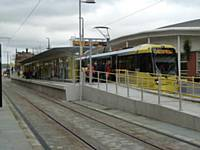 Tram 3003 stands at Central stop Oldham on the first day of operation with Sainsburys in the background. Photo R Clarke