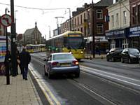 Trams mix with cars on Union Street Oldham as 3009 heads for Rochdale next stop Oldham Central.  Photo R Clarke