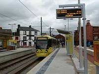 Tram 3018 arrives at King Street stop on a Didsbury bound service on the first day of town centre service 27/01/2014. Photo R Clarke