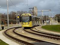 Tram 3030 Departs from the new Westwood stop on it's way to re-join the original route at Werneth towards Didsbury on 27/01/2014. Photo R Clarke