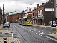Tram in Union Street between Mumps and Oldham Central 27.01.2014.  Alwyn Smith