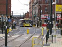 One of the first day trams at Rhodes Bank between Oldham Central and Mumps 27.01.2014.  Alwyn Smith