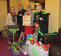Presenting the wheel project toys to Heywood Children's Contact Centre