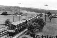 3 x 3 car with yellow front panel eastbound above Towneley, Burnley, on 16 July 1966. I Holt