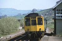 An almost head-on shot of a class 110 at Mytholmroyd before the forest took over and when the signalbox was still in use, circa 1975. R S Greenwood