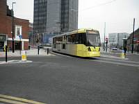 A Rochdale bound tram enters the Town Centre stop from East Didsbury on Monday 31st March 2014. J Dillon