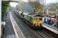 66514 passes through Castleton on an Immingham to Fiddlers Ferry coal train on 21 October 2015. R Clarke