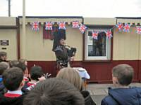 HEYWOOD 175. Heywood schoolchildren enthralled with the piper.  John Dillon.