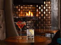 Enjoy cocktails by the fire in the bar area at our Italian Restaurant, Cenetta