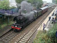 P8. Richard S Greenwood MBE STORM historian films the Flying Scotsman at Castleton Station 28 September 2016. S Perryman