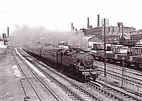 Ex LM&SR Fowler 2-6-4T 42311 heads a SO Bradford-Manchester express past Castleton East Junction in 1960. The building visible above the loco was formerly a M&LR engine shed before conversion to a goods shed in the 1880's. Richard S. Greenwood