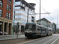 Metrolink tram 1020 heads down Lower Mosley Street in Manchester city centre on its way to Altrincham. In 2012 trams from Rochdale and in 2011 Oldham will follow this route as far as Trafford Bar and then run to Chorlton.  Tony Young.