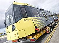 The first of forty new Metrolink trams, number 3001, arrives after its journey from Vienna in July 2009. They will enter service on existing Metrolink routes towards the end of 2009 and will run to Oldham and Rochdale in 2011.  Tony Young