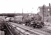 BR Standard 4MT 2-6-4T 80046 heads the 4.35 p.m. Rochdale-Blackpool  express at Castleton in 1959. It appears that a schoolboy has hitched a lift on the engine.  Richard S. Greenwood