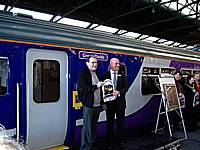 STORM Chairman Richard Greenwood receives a replica train headboard from Northern's Lee Wasnidge at the naming ceremony for 156466 on October 3rd 2009.  Alwyn Smith