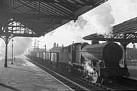 photo R4 'Austin Sevens' still much in evidence 49624 enters Rochdale station shadows down platform on 11th Jan 1960.  RS Greenwood