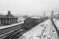 photo R6 45337, an Agecroft Shed engine, on the midday Wakefield to Manchester Victoria stopper, approaches Smithy Bridge Station Down platform, 15th Jan 1960(45337 may be returning to ELR at Bury). RS Greenwood.