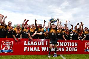 Rochdale Hornets celebrate victory in the League One Promotion Final against Toulouse Olympique