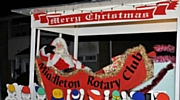 The Rotary Club of Middleton Christmas Float tours the streets of Middleton