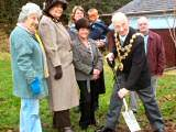 The Mayor Councillor Peter Evans plants a tree