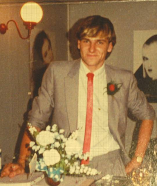 A 23-year old Greg Couzens at the opening of his hair salon in 1983.