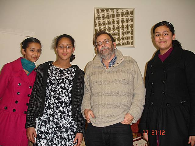 Sisters Harisah, Armani and Alina Khaliq with author Jan Needle.