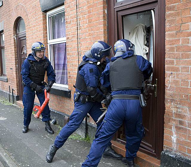 Officers break down a door during this morningu0027s drug raids. & Rochdale News | News Headlines | Arrests made during dawn drug raids ...