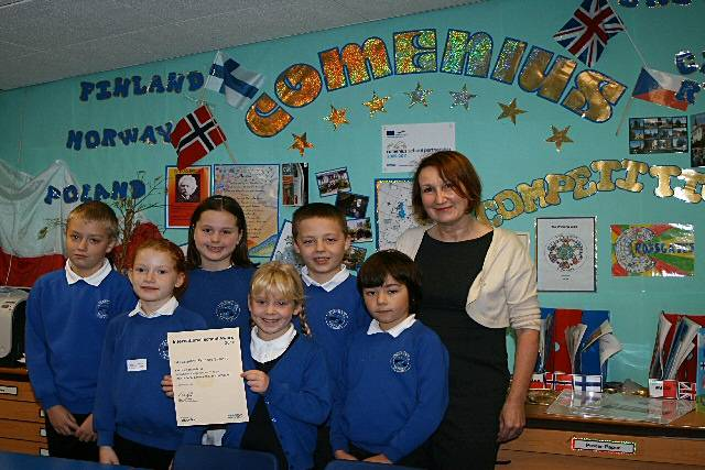 Ryan Thompson, Cloe Wainwright, Oliver Stokes, Ellie Warren, Lauren Mercer and Samueal Catlow show of their award certificate with thier teacher Kathryn Alker