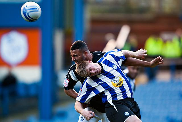 Sheffield Wednesday 2 - 0 Rochdale<br /> Marcus Holness grits his teeth to win the header against Neil Mellor