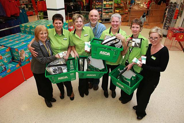 Asda colleagues with Mind and Body Natural Health Centre in Bury staff pictured at Asda store, Rochdale. 